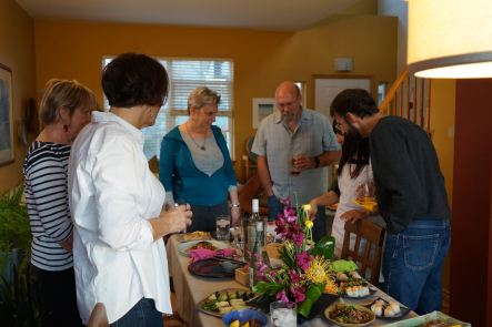 guests gathering around the table