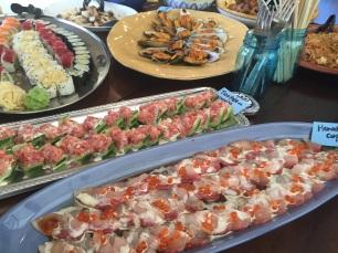 Hamachi Carpaccio and Tuna poke on cucumber slices