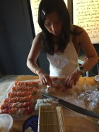 miho cutting sushi rolls at the party